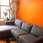 Hermes Orange Walls and Comfort Works Karlstad sofa in Kino Grey
