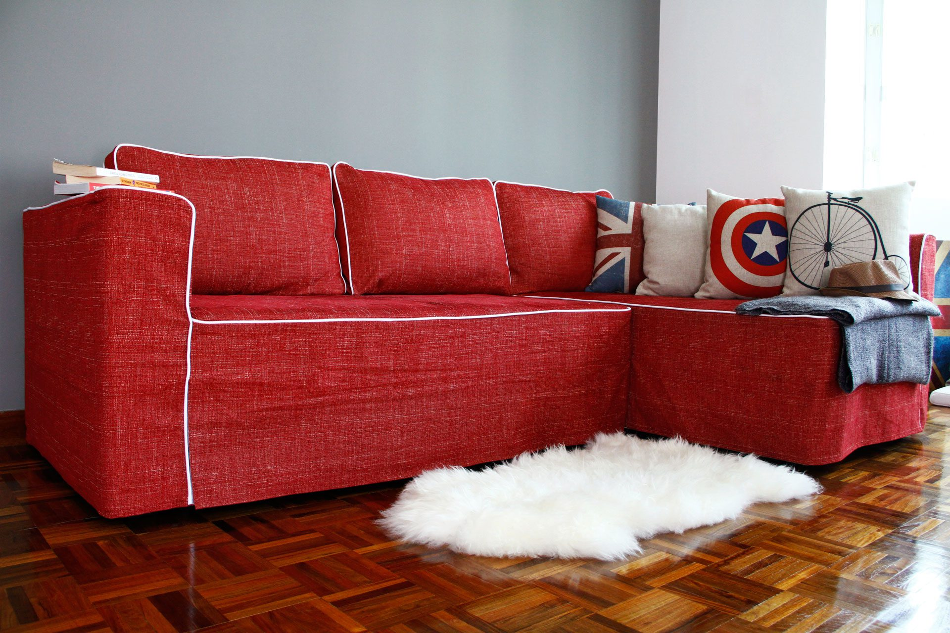 IKEA Manstad Sofa with slipcover from Comfort Works with Nomad Red fabric customized with white contrast piping