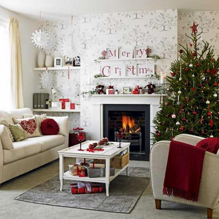 Red accents this white living room perfectly