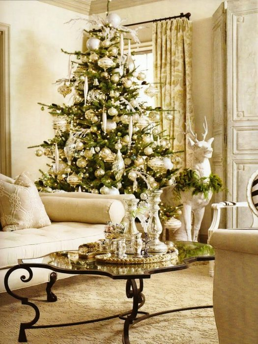Simply gorgeous white gold and green living room. While in the corner, the tree still sets everything off