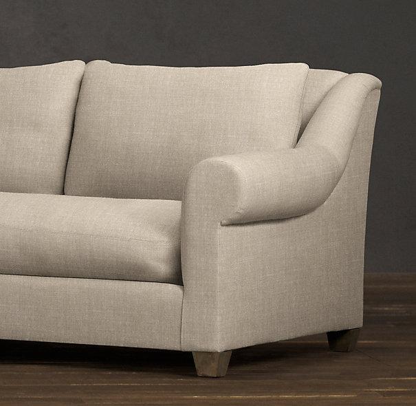 Il divano belga con bracciolo rotondo