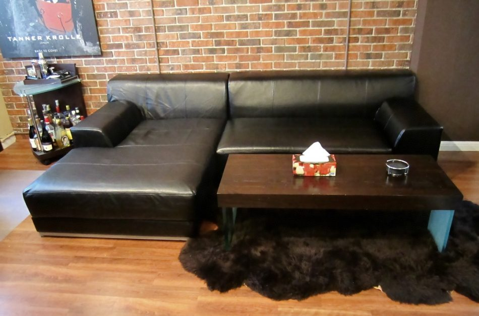 Sofa with black leather slipcover from Comfort Works
