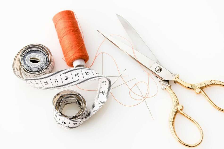 Sewing materials: scissors, thread and tape measure.