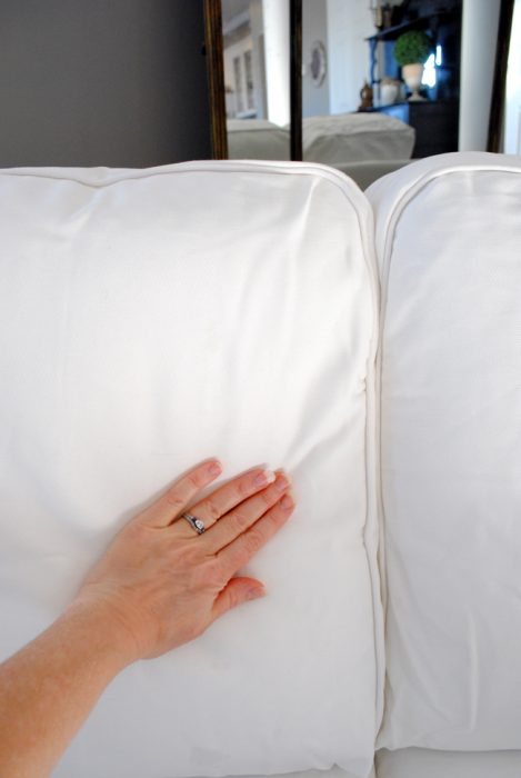 Smoothing Over Wrinkled Sofa Slipcovers with Hands