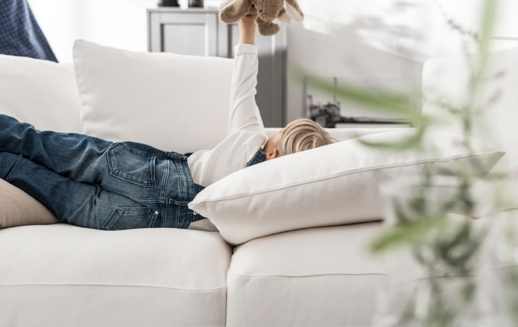 Boy lying on IKEA Gronlid Loose Back Cushion