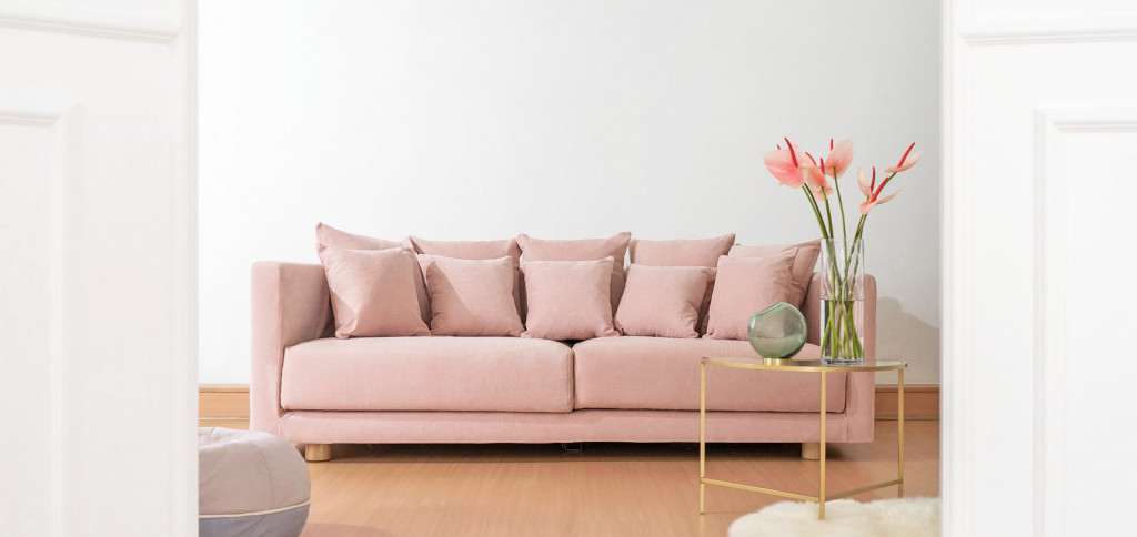 Sofa covered in pink cotton fabric