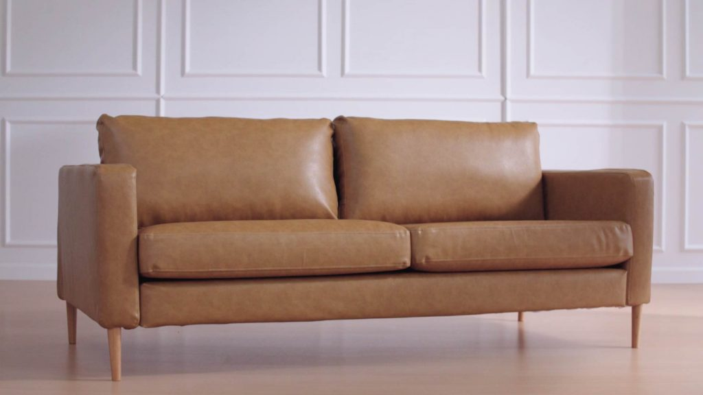 Sofa in faux leather fabric. Looks just as good as the real thing.