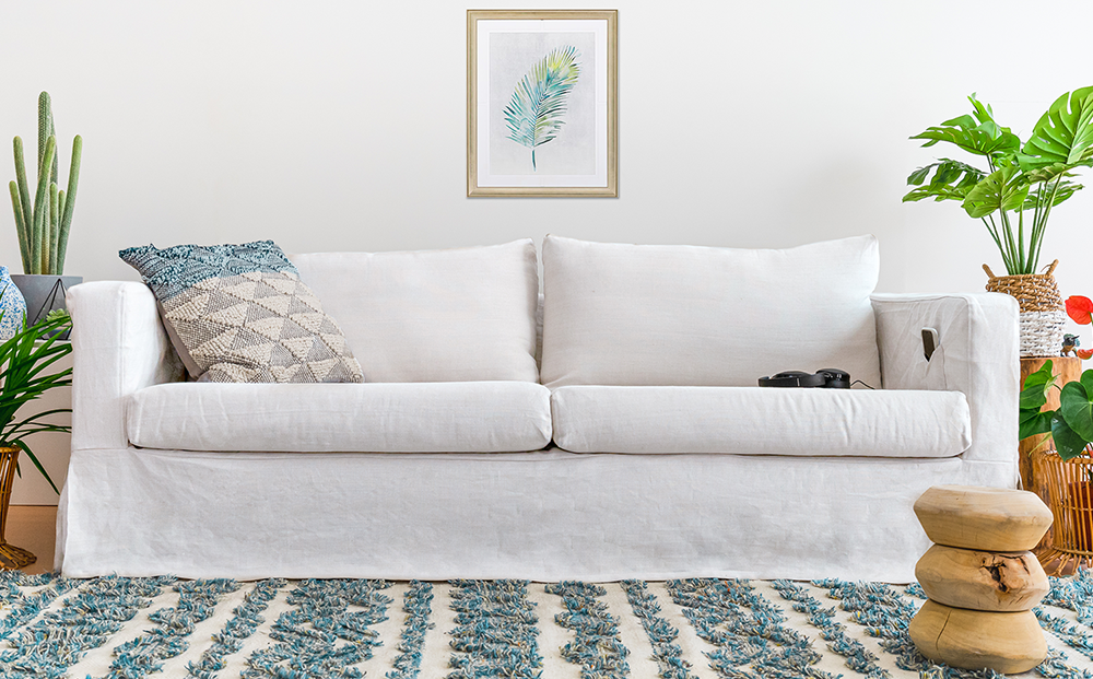 a white linen sofa made from pure linen