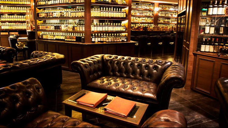 The leather Chesterfield sofa is a staple in whisky and cigar lounges