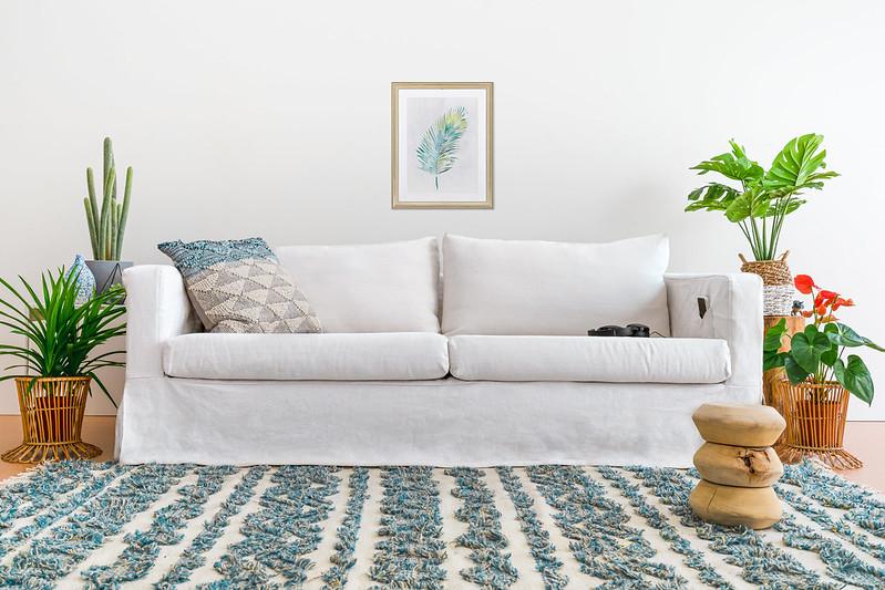 karlstad sofa in white linen slipcovers