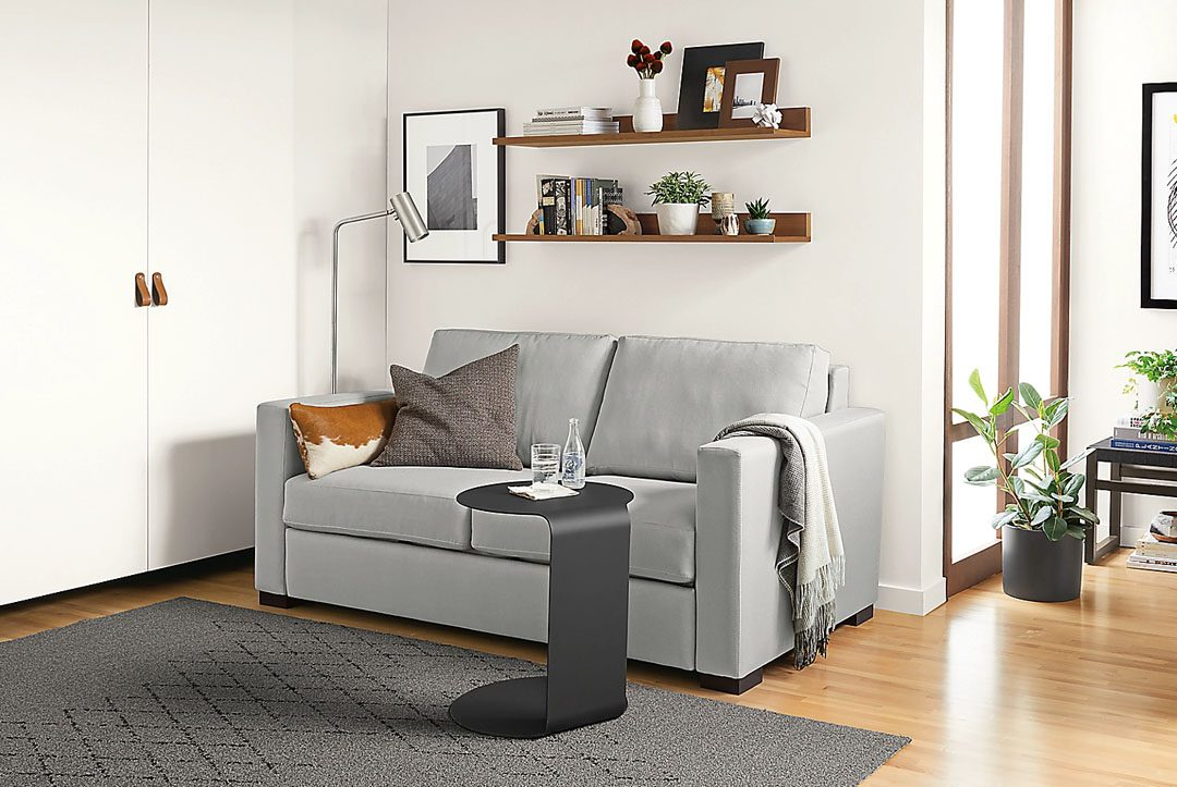 a tiny sofa in an apartment