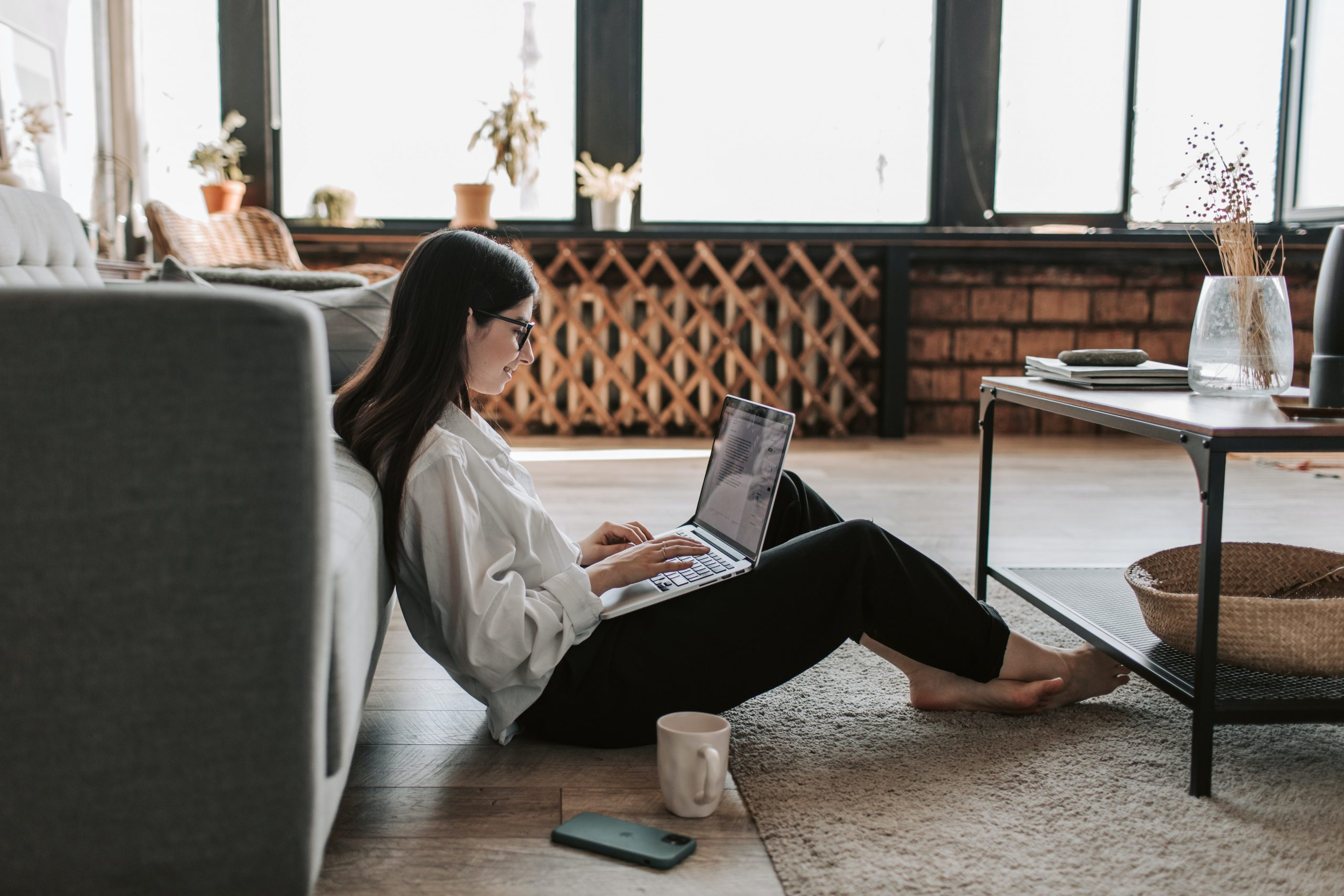 Lady sitting on floor with laptop