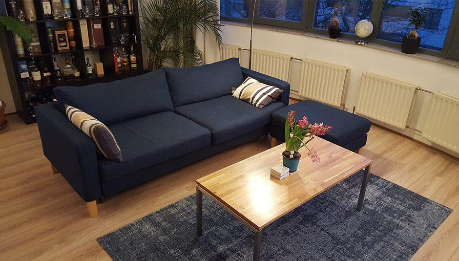 An IKEA Karlstad sofa with the footstool
