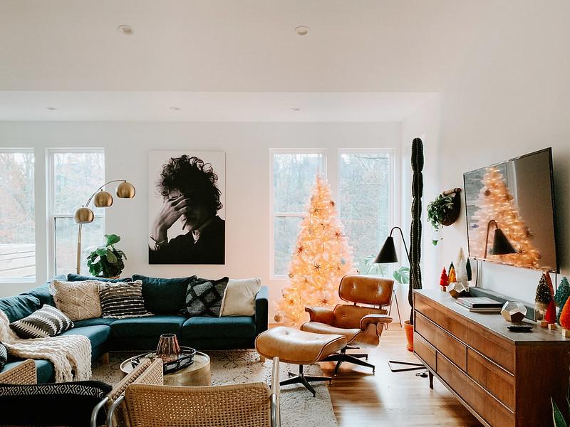 Blue Karlstad sofa in mid-century modern living room