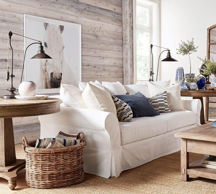 White potterybarn sofa slipcovered in white in a farmhouse living room