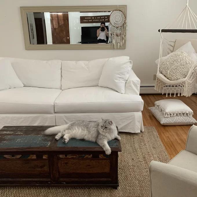 huge and deep white farmhouse slipcovered sofa